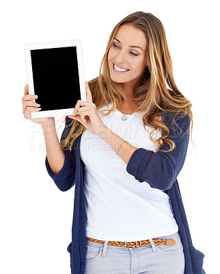 Buy stock photo Studio shot of a young woman looking at a digital tablet that she is holding