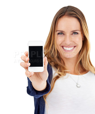 Buy stock photo Studio shot of a young woman displaying her cellphone