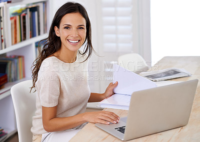 Buy stock photo Portrait of an attractive young woman using her laptop at home