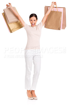 Buy stock photo Full-length studio portrait of an attractive young woman holding up shopping bags