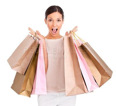 Buy stock photo An attractive woman looking excited while holding up shopping bags