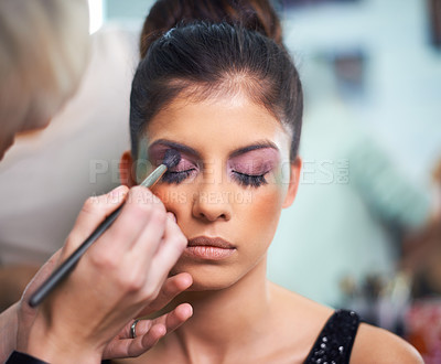Buy stock photo A young woman having makeup applied