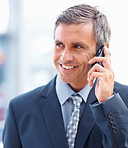 Elderly business man smiling during a conversation on the mobile