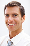 Closeup of a business man smiling over white