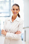 Successful young business woman smiling confidently