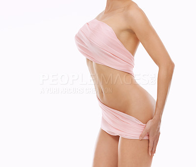 Buy stock photo Cropped shot of a young woman covered with a sheet against a white background