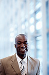 An African American business man smiling