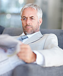 Mature business man reading newspaper