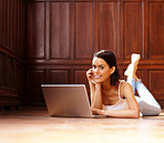 Beautiful young female using laptop - Indoor