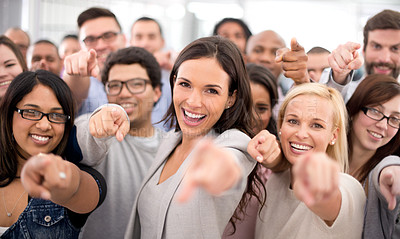 Buy stock photo Shot of a group of smiling businesspeople pointing at the camera