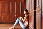 Happy young lady smiling with laptop - Copyspace