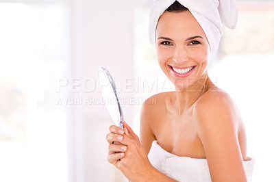 Buy stock photo Portrait of a beautiful woman smiling while holding a hand mirror