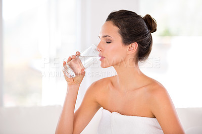 Buy stock photo Side view of a beautiful woman drinking a glass of water