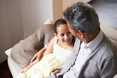 Buy stock photo Shot of a little girl spending time with her grandfather