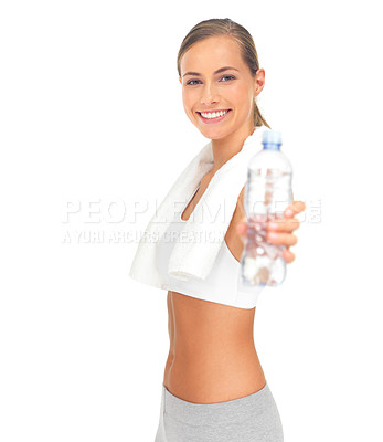 Buy stock photo Portrait of an attractive young woman holding out a bottle of water against a white background