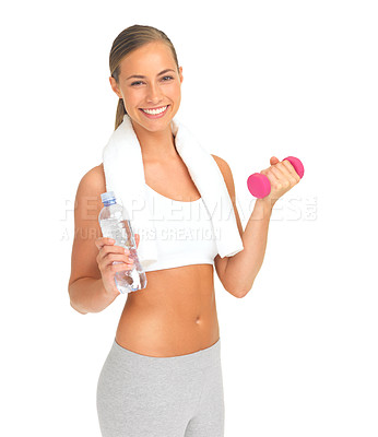 Buy stock photo Portrait of an attractive young woman holding a dumbbell and a bottle of water against a white background