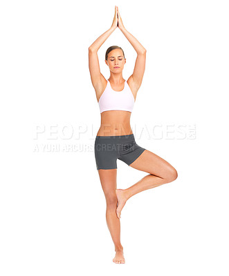 Buy stock photo Studio shot of an attractive young woman meditating in an upright position
