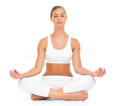 Buy stock photo Shot of an attractive young woman practicing the art of meditation