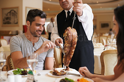 Buy stock photo A happy couple enjoying a meal at a fine dining restaurant
