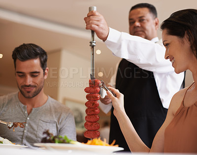 Buy stock photo A happy couple at a restaurant