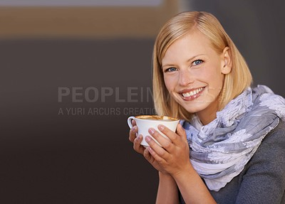 Buy stock photo Portrait of a young woman drinking coffee in a cafe