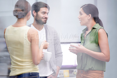 Buy stock photo Cropped shot of three work colleagues in the office