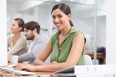Buy stock photo A young businesswoman working at her desk in the office