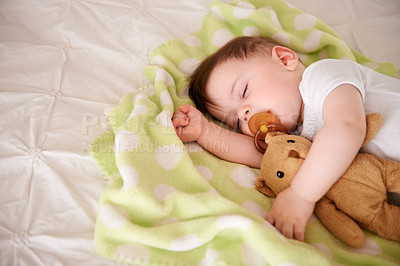 Buy stock photo Cropped shot of an adorable baby boy taking a nap