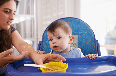 Buy stock photo Cropped shot of a mother feeding her baby boy