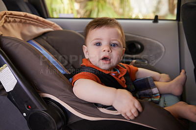 Buy stock photo Cropped shot a baby boy in a car seat