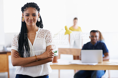 Buy stock photo A young woman smiling in her office