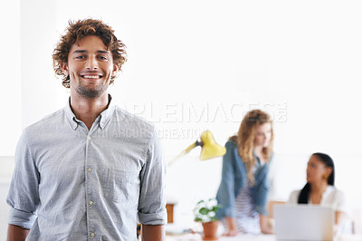 Buy stock photo Portrait of a young office professional with his colleagues in the background