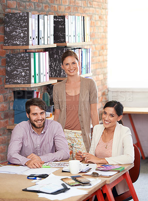 Buy stock photo Young creative professionals working in an office