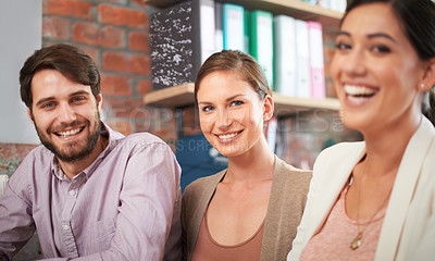 Buy stock photo Cropped shot of three business associates working together on a project
