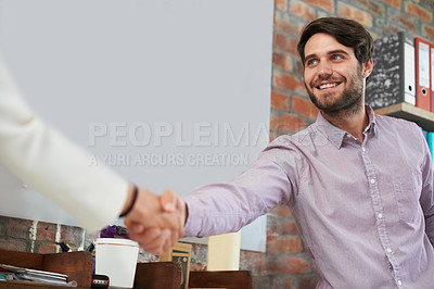 Buy stock photo A young business man shaking hands with someone