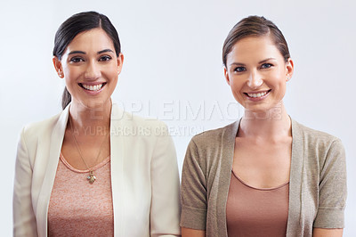 Buy stock photo Two business women smiling at the camera