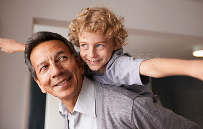 Buy stock photo A grandfather giving his grandson a piggyback ride