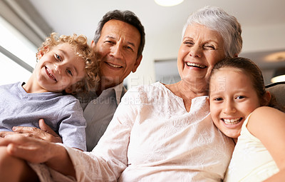 Buy stock photo Portrait of grandparents with their grandchildren at home