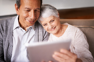 Buy stock photo A senior couple using a digital at home