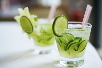 Buy stock photo Two beverages in glasses decorated with cucumbers