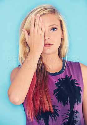 Buy stock photo Studio shot of an attractive and trendy young woman covering her one eye