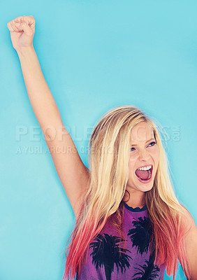 Buy stock photo Studio shot of an attractive young woman punching the air
