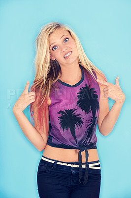 Buy stock photo A trendy young woman making a face while pointing at her hair