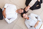 Business people lying on the floor and looking upwards