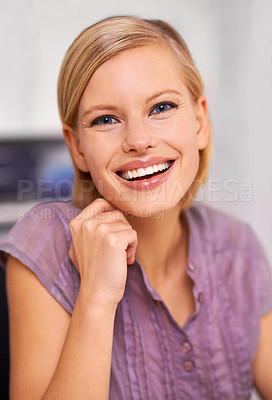 Buy stock photo Portrait of an attractive smiling young woman sitting at a desk