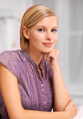 Buy stock photo Portrait of an attractive young woman sitting at a desk