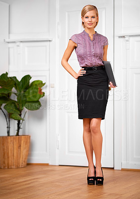 Buy stock photo Portrait of a beautiful young office worker standing with confidence