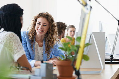 Buy stock photo Shot of young designers talking while working on their computers