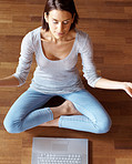 Healthy lifestyle - Young female sitting in lotus position with laptop