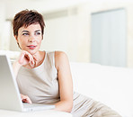 A business woman sitting with a laptop in front